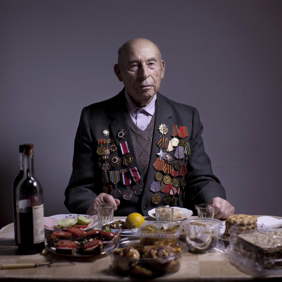 In this photo made Thursday, April 11, 2013, Soviet Jewish World War Two veteran Boris Ginsburg poses for a portrait at his house in the southern Israeli city of Ashdod. Ginsburg, born in Belorussia, was kept by a German garrison in the Lenin ghetto since 1941 until its destruction by partisan units in September 1942. In 1942 he joined the partisans for two years and in 1944 he joined the Red Army as a combat soldier and fought till the and of the war. Ginsubrg demobilized in 1947 and immigrated to Israel in 2001. About 500,000 Soviet Jews served in the Red Army during World War Two, and the majority of those still alive today live in Israel. (AP Photo/Oded Balilty)