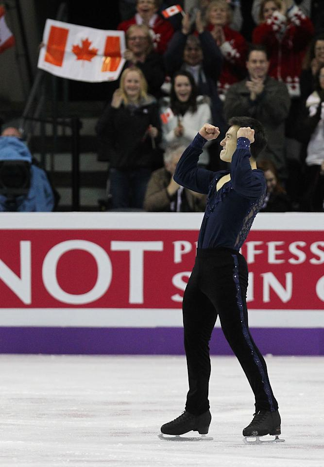 LONDON, CANADA - MARCH 13:  Patrick Chan of Canada pumps his fists at the end of his performance in the Men's Short Program during the 2013 ISU World Figure Skating Championships at Budweiser Gardens on March 13, 2013 in London, Ontario, Canada.  (Photo by Dave Sandford/Getty Images)