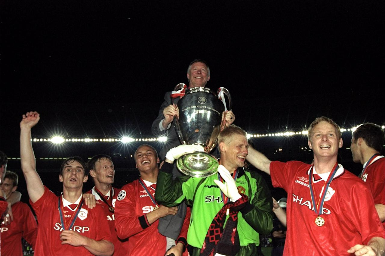 26 May 1999:  Alex Ferguson celebrates with Manchester United players and the European Cup after winning the European Champions League Final against Bayern Munich in the Nou Camp Stadium, Barcelona, Spain. Manchester United won 2 - 1 with both United goals scored during injury time, to secure the treble of League, FA Cup and European Cup. \ Mandatory Credit: Shaun Botterill /Allsport