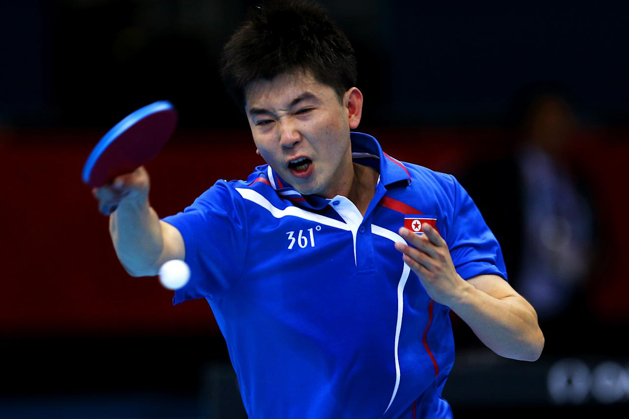 LONDON, ENGLAND - JULY 28:  Hyok Bong Kim of DPR Korea plays a forehand against  Timothy Wang of the United States during their Men's Singles Table Tennis match on Day 1 of the London 2012 Olympic Games at ExCeL on July 28, 2012 in London, England.  (Photo by Feng Li/Getty Images)