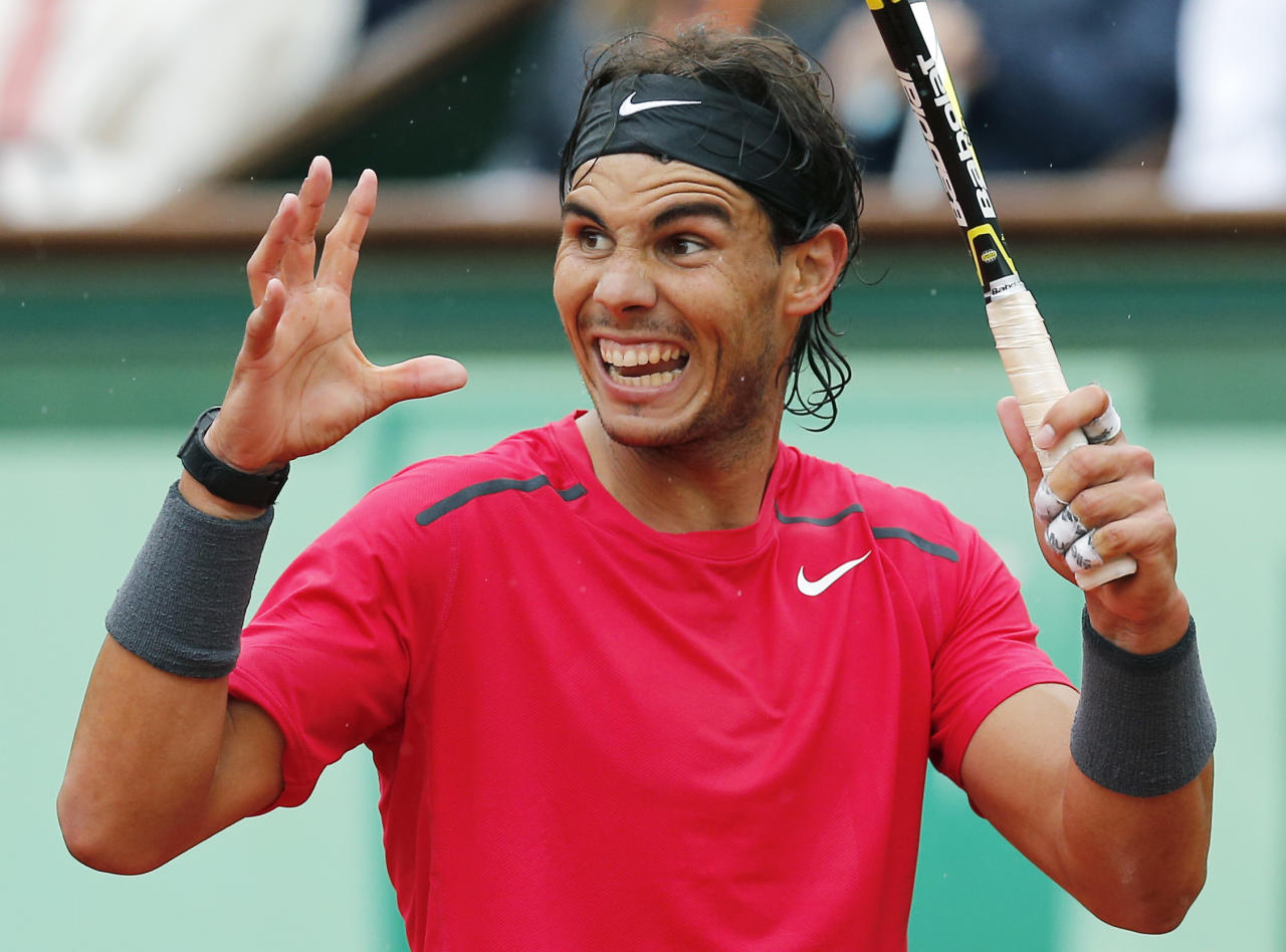 Spain's Rafael Nadal reatcs as he plays Serbia's Novak Djokovic during their men's final match in the French Open tennis tournament at the Roland Garros stadium in Paris, Sunday, June 10, 2012. (AP Photo/Michel Euler)