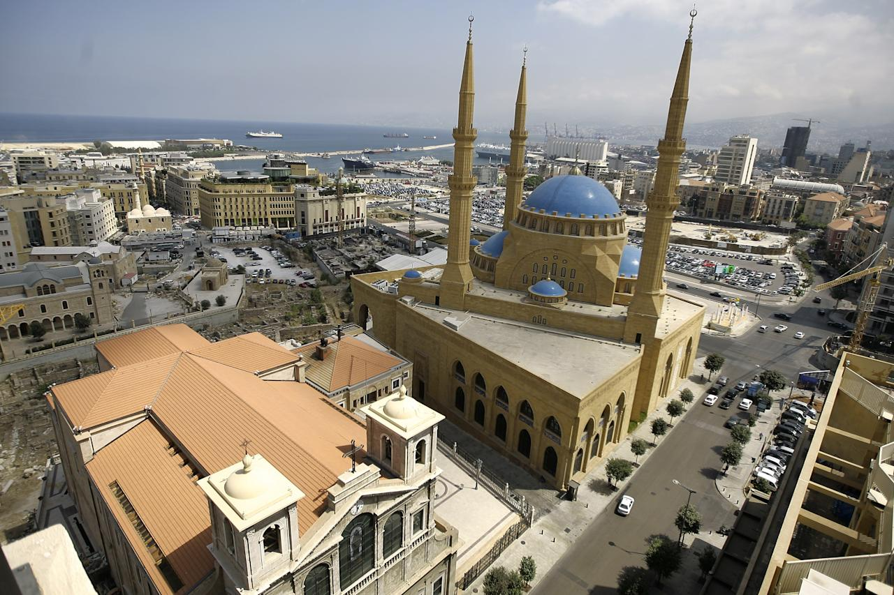 An areal view shows the main Sunni Muslim Mohammed al-Amin mosque built at the side of the main Christian Maronites Church of Saint Georges in downtown Beirut on August 30, 2010. AFP PHOTO/JOSEPH EID