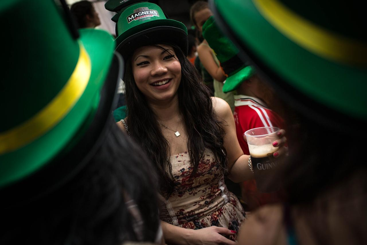 SINGAPORE - MARCH 17: A group of women drink beer and celebrate St Patricks Day during the Singapore St Patrick's Day street Festival at Boat Quay on March 17, 2013 in Singapore.  Singapore's Irish community gathered at Boat Quay for a three-day-long St Patrick's Day Street Festival which featured street performances, buskers, and Irish food and drink.  (Photo by Chris McGrath/Getty Images)