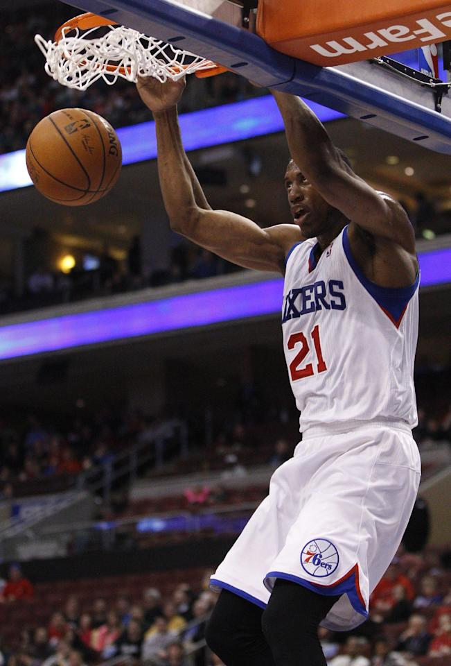 Philadelphia 76ers' Thaddeus Young dunks the ball during the first half of an NBA basketball game against the Dallas Mavericks, Friday, Feb. 21, 2014, in Philadelphia. (AP Photo/Chris Szagola)