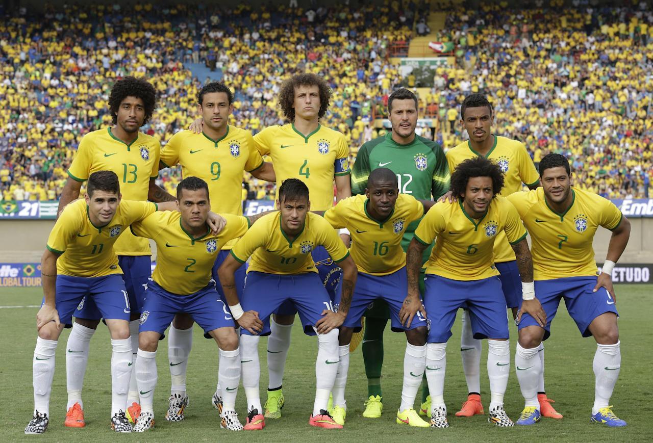 Brazil's national soccer team poses for pictures prior to a friendly soccer match against Panama at the Serra Dourada stadium in Goiania, Brazil, Tuesday, June 3, 2014. Back row, from left: Dante, Fred, David Luiz, goalkeeper Julio Cesar, Luiz Gustavo; first row from left: Oscar, Daniel Alves, Neymar, Ramires, Marcelo, and Hulk. Brazil is preparing for the World Cup soccer tournament that starts on 12 June. Brazil won the match 4-0. (AP Photo/Andre Penner)