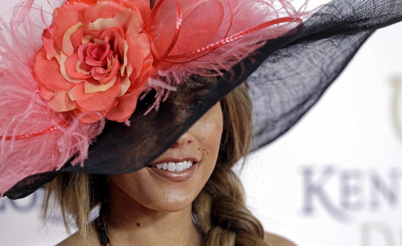 Model and television personality Bonnie Jill Laflin arrives to attend the 139th Kentucky Derby at Churchill Downs Saturday, May 4, 2013, in Louisville, Ky. (AP Photo/Darron Cummings)