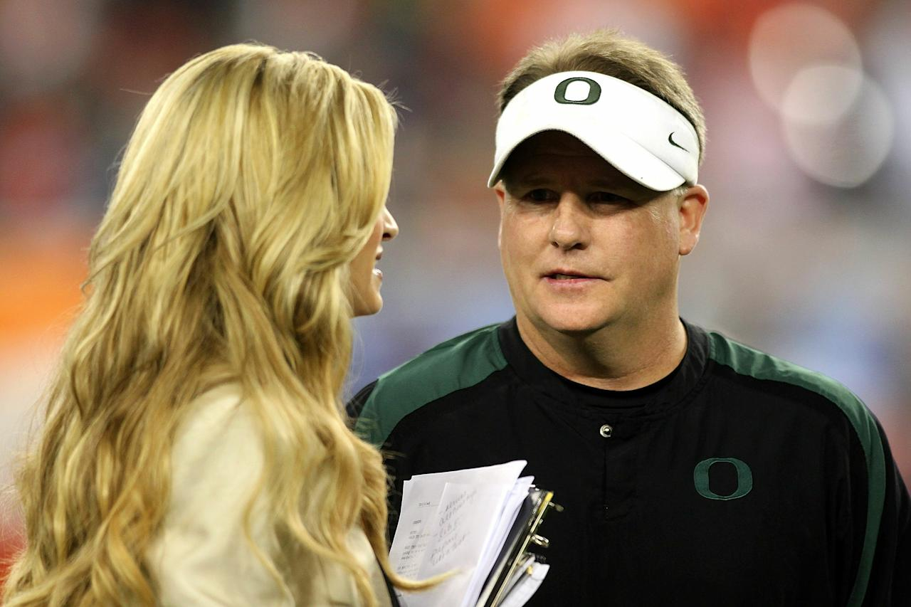 GLENDALE, AZ - JANUARY 10:  Head coach Chip Kelly of the Oregon Ducks talks with ESPN sideline reporter Erin Andrews before the Tostitos BCS National Championship Game between the Ducks and the Oregon Ducks at University of Phoenix Stadium on January 10, 2011 in Glendale, Arizona.  (Photo by Jonathan Ferrey/Getty Images)