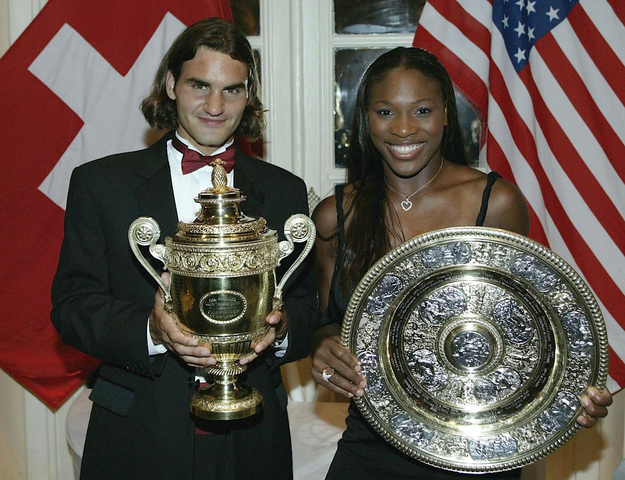 LONDON - JULY 6:  (FILE PHOTO) Wimbledon Champions Roger Federer of Switzerland and Serena Williams of the U.S. pose for photographs prior to attending the Wimbledon Ball at the Savoy Hotel on July 6, 2003 in London.  (Photo by Alex Livesey/Getty Images)  Celebrating 125 Years Of Wimbledon  Please refer to the following profile on Getty Images Archival for further imagery.  http://www.gettyimages.co.uk/Search/Search.aspx?EventId=115973863&EditorialProduct=Archival Fashions  http://www.gettyimages.co.uk/Search/Search.aspx?EventId=115973067&EditorialProduct=Archival  For further imagery also see this lightbox http://www.gettyimages.co.uk/Account/MediaBin/LightboxDetail.aspx?Id=19295855&MediaBinUserId=3936288