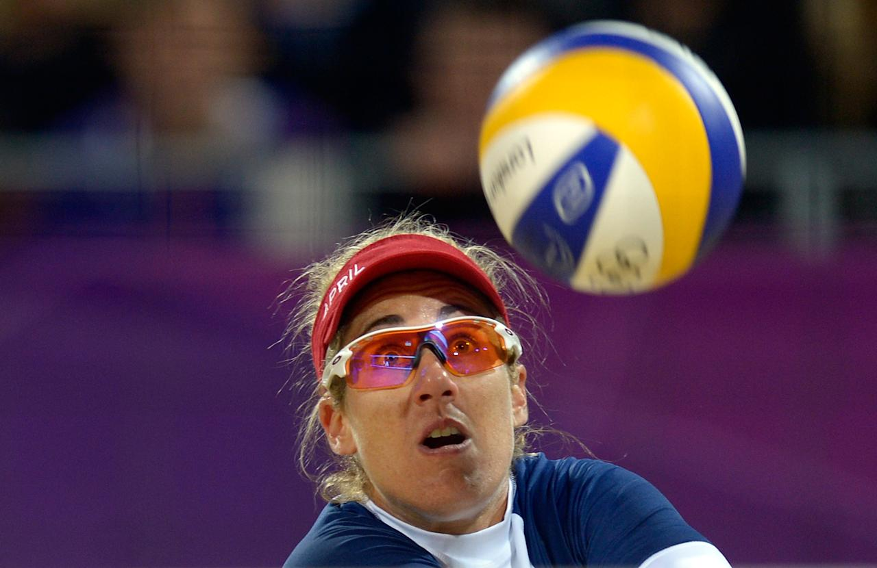 April Ross from the US eyes the ball during the women's beach volleyball preliminary phase Pool D match against Argentina's Ana Gallay and Maria Virginia Zonta on The Centre Court Stadium in Horse Guards Parade on London on July 29, 2012, for the London 2012 Olympic Games.  The US won 2-0.    AFP PHOTO / DANIEL GARCIADANIEL GARCIA/AFP/GettyImages