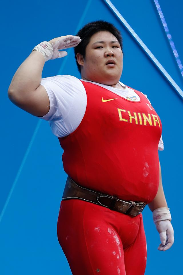 LONDON, ENGLAND - AUGUST 05:  Lulu Zhou of China  during the Women's 75kg Weightlifting on Day 9 of the London 2012 Olympic Games at ExCeL on August 5, 2012 in London, England.  (Photo by Jamie Squire/Getty Images)