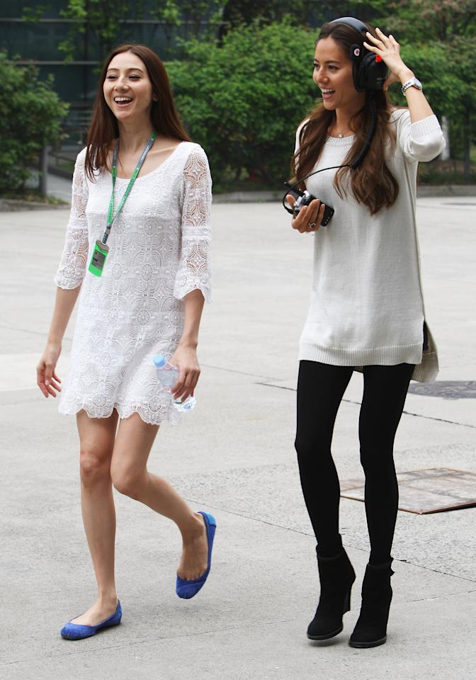 SHANGHAI, CHINA - APRIL 14:  McLaren driver Jenson Buttons girlfriend Jessica Michibata (R) with her younger sister Angelica Michibata walks in the paddock before qualifying for the Chinese Formula One Grand Prix at the Shanghai International Circuit on April 14, 2012 in Shanghai, China.  (Photo by Ker Robertson/Getty Images)
