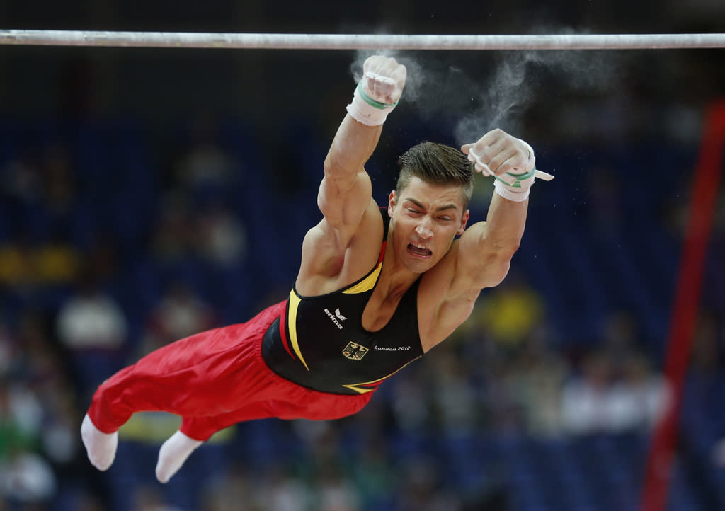 German gymnast Plilipp Boy slips off the horizontal bar during the Artistic Gymnastics men's qualification at the 2012 Summer Olympics, Saturday, July 28, 2012, in London. (AP Photo/Matt Dunham)