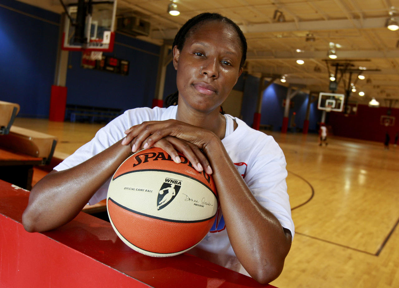File-This May 15, 2009 file photo shows former Atlanta Dream forward Chamique Holdsclaw posing for a portrait after a basketball workout in Jonesboro, Ga. (AP Photo/John Bazemore, File)