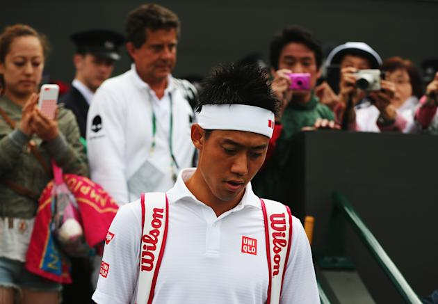 Japan's Kei Nishikori couldn't finish off lucky loser Simone Bolelli Saturday. Deadlocked at 3-3 in the fifth set, they have to return Monday to complete the match. (Photo by Dan Kitwood/Getty Images)