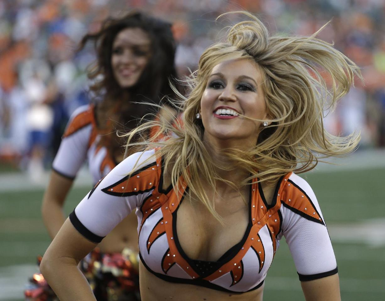 Cincinnati Bengals cheerleaders perform during the first half of an NFL preseason football game against the Indianapolis Colts, Thursday, Aug. 28, 2014, in Cincinnati. (AP Photo/Tom Uhlman)