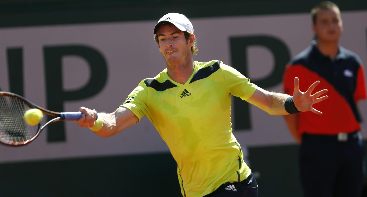 Britain's Andy Murray returns the ball during the semifinal match of the French Open tennis tournament against Spain's Rafael Nadal at the Roland Garros stadium, in Paris, France, Friday, June 6, 2014. (AP Photo/Darko Vojinovic)
