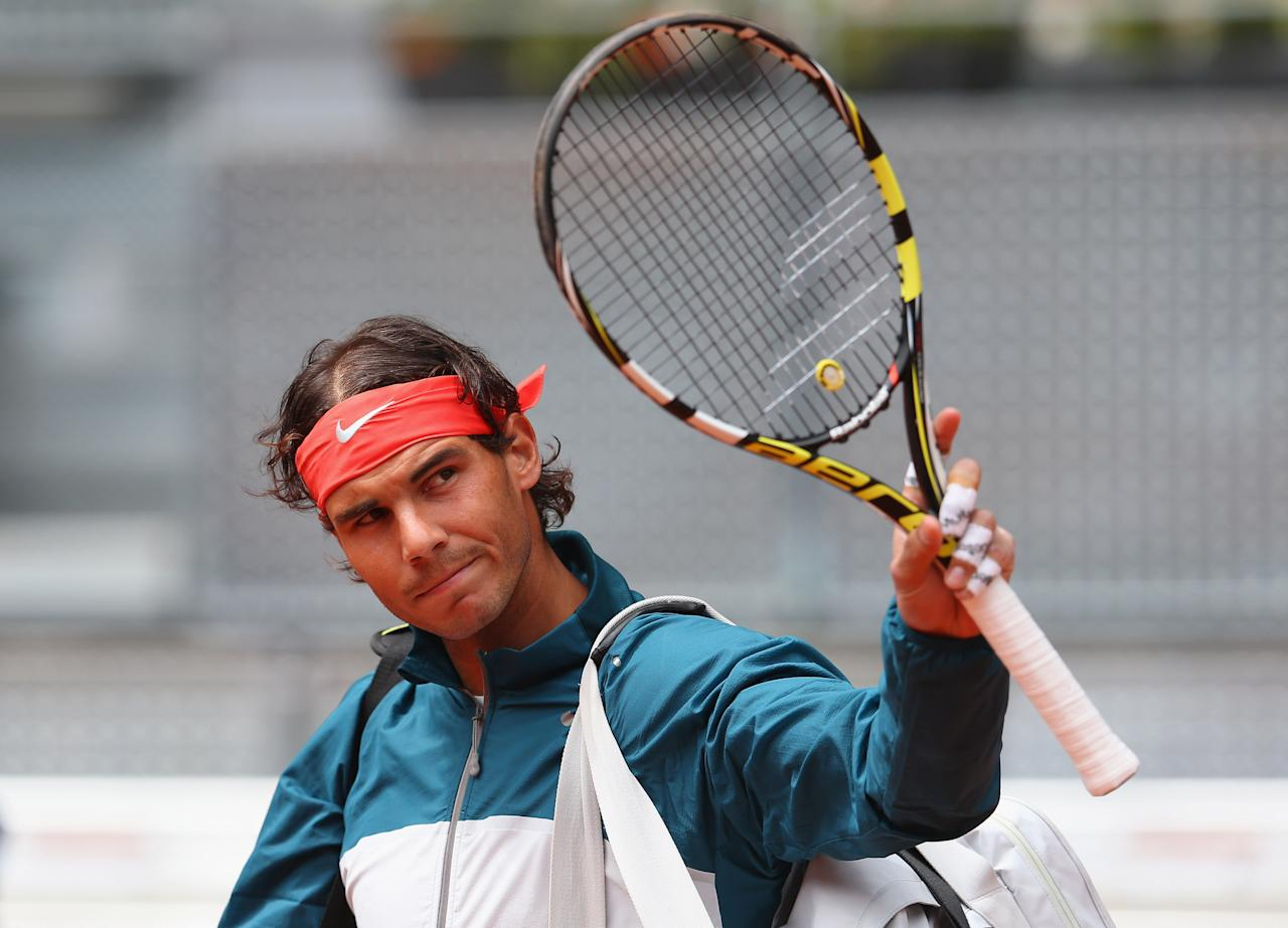 MADRID, SPAIN - MAY 08:  Rafael Nadal of Spain arrives on court before his match with Benoit Paire of France during day five of the Mutua Madrid Open tennis tournament at the Caja Magica on May 8, 2013 in Madrid, Spain.  (Photo by Julian Finney/Getty Images)