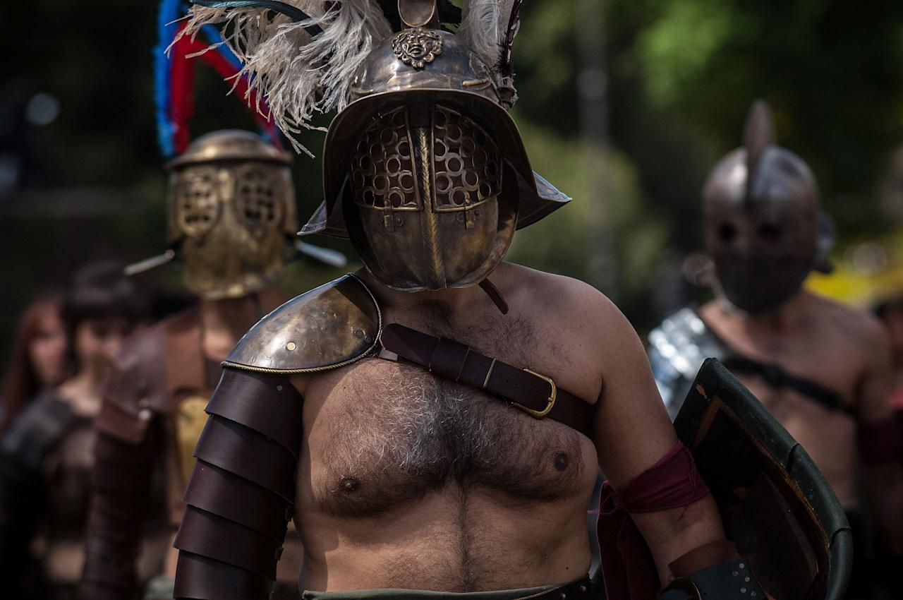 ROME, ITALY - APRIL 21: Actors dressed as ancient gladiators march in front of the Coliseum in a commemorative parade during festivities marking the 2,766th anniversary of the founding of Rome on April 21, 2013 in Rome, Italy. The capital celebrates its founding annually based on the legendary foundation of the Birth of Rome. Actors dressed as the denizens of ancient Rome participate in parades and re-enactments of the ancient Roman Empire. According to legend, Rome had been founded by Romulus in 753 BC in an area surrounded by seven hills. (Photo by Giorgio Cosulich/Getty Images)