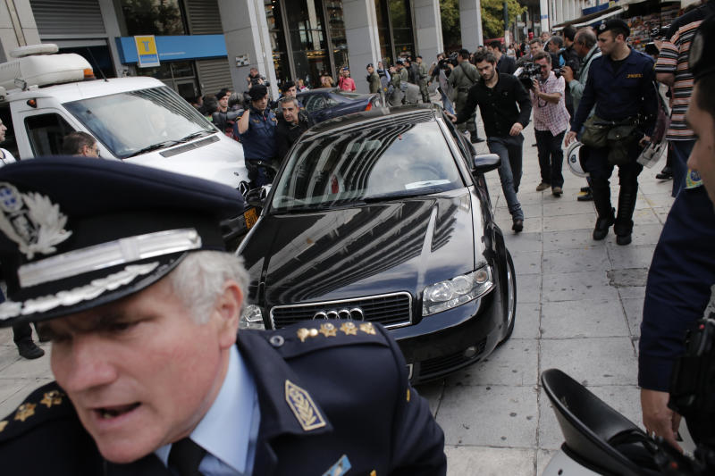 Greek bailout creditors get an earful in Athens