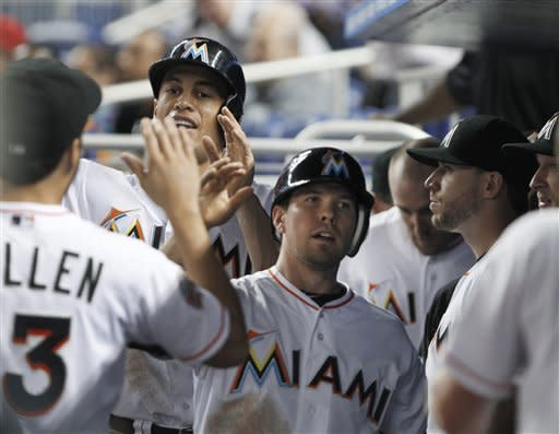 Nolasco sets win record as Miami beats Rockies 7-6