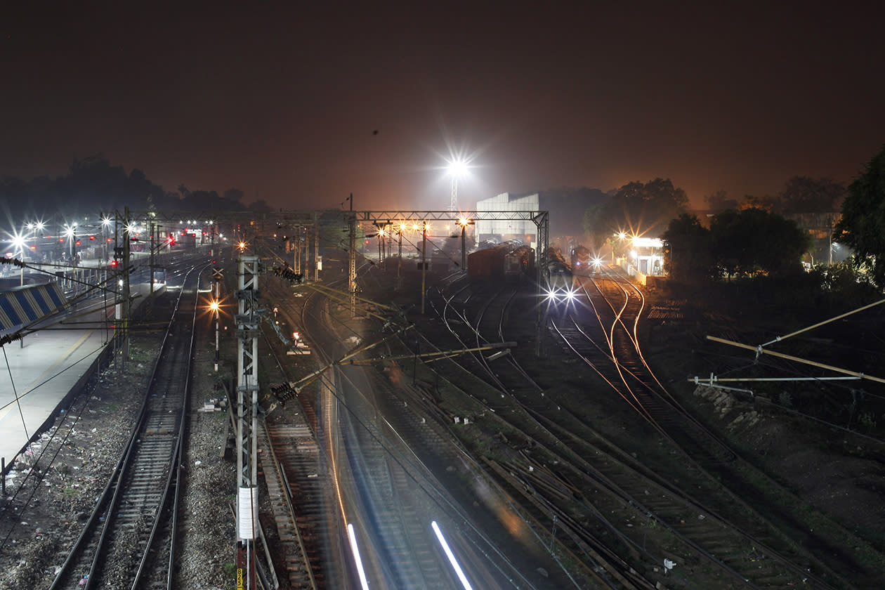 A train approaches a railway station in Allahabad, India.