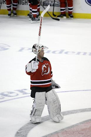 New Jersey Devils goalie Martin Brodeur waves to the crowd after an NHL hockey game against the Boston Bruins in Newark, N.J., Sunday, April 13, 2014. The Devils won 3-2. (AP Photo/Mel Evans)