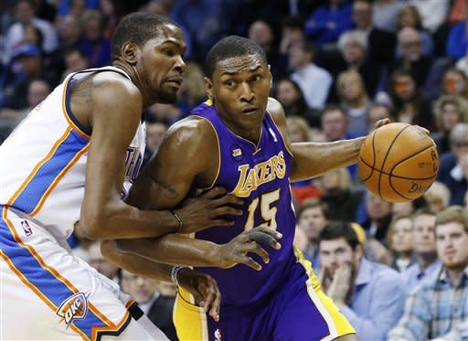 Los Angeles Lakers forward Metta World Peace (15) drives around Oklahoma City Thunder forward Kevin Durant (35) in the first quarter of an NBA basketball game in Oklahoma City, Tuesday, March 5, 2013. (AP Photo/Sue Ogrocki)