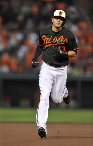Baltimore Orioles Manny Machado trots to third after hitting a solo home run against the New York Yankees in the first inning of a baseball game, Sunday, June 30, 2013, in Baltimore. (AP Photo/Gail Burton)
