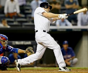 Headley drives in the winning run in the bottom of the 14th inning. (Getty Images)