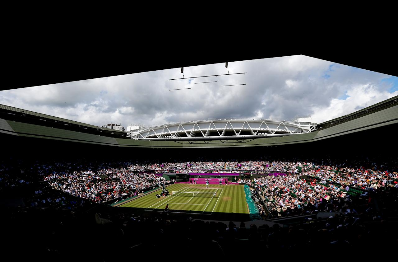 LONDON, ENGLAND - AUGUST 03:  A general view of Wimbledon is seen as Juan Martin Del Potro of Argentina returns a shot against Roger Federer of Switzerland in the Semifinal of Men's Singles Tennis on Day 7 of the London 2012 Olympic Games at Wimbledon on August 3, 2012 in London, England.  (Photo by Clive Brunskill/Getty Images)