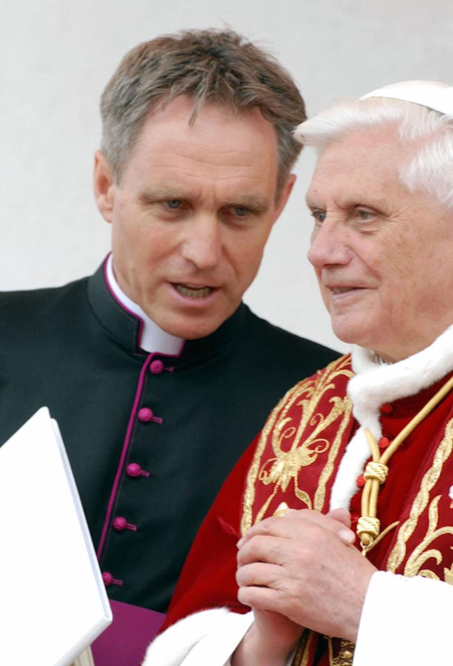 Reverend Georg Gaenswein, the private secretary of Benedict XVI, speaks to the Pope during a visit of the home town of Pope John Paul II on May 27, 2006 in Wadowice, Poland. The Pope is on a four-day apostolic visit to Poland. (Photo by Laski Diffusion - Wojtek Laski/Getty Images)