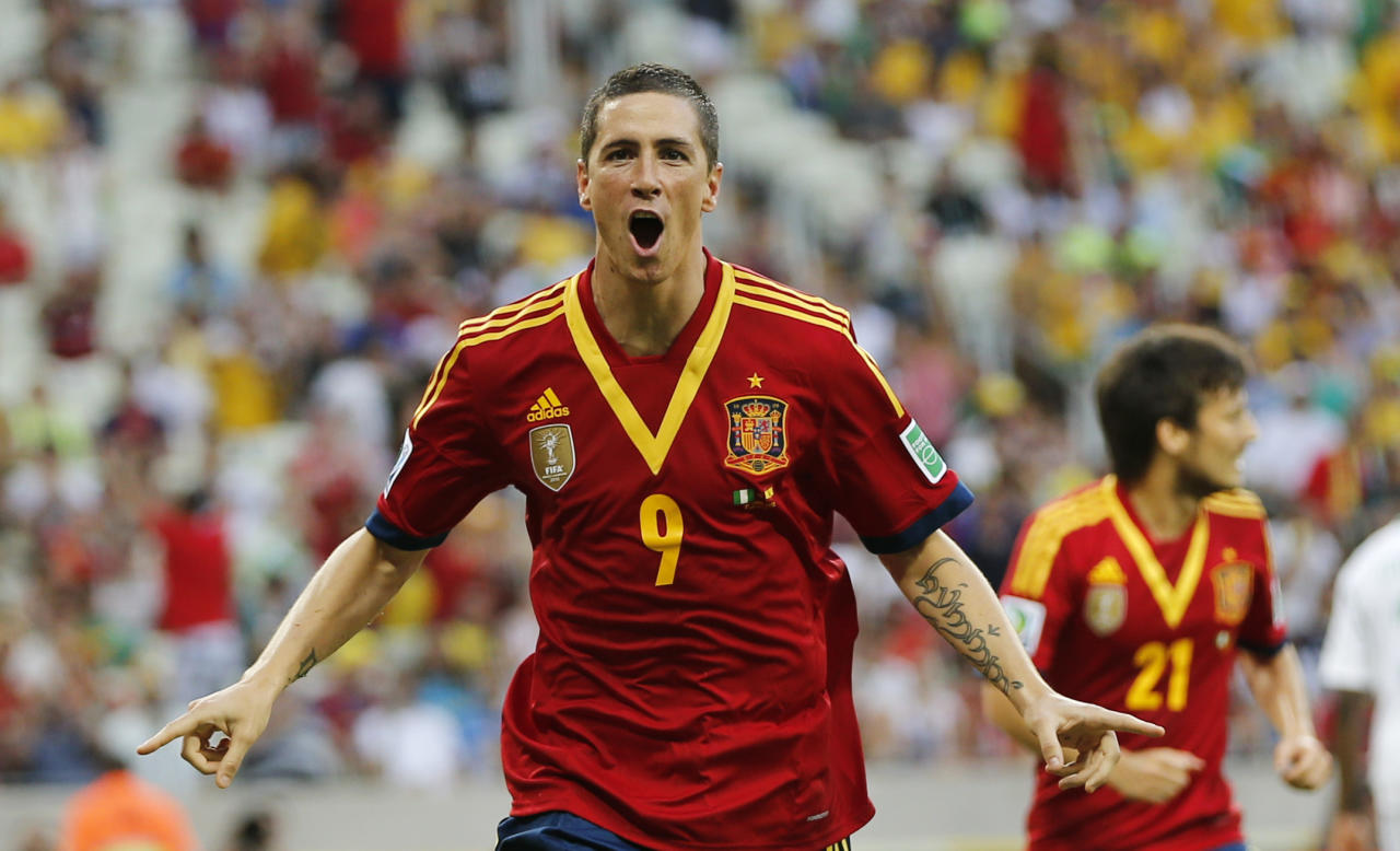 Spain's Fernando Torres celebrates scoring his side's 2nd goal during the soccer Confederations Cup group B match between Nigeria and Spain at the Castelao stadium in Fortaleza, Brazil, Sunday, June 23, 2013. (AP Photo/Fernando Llano)