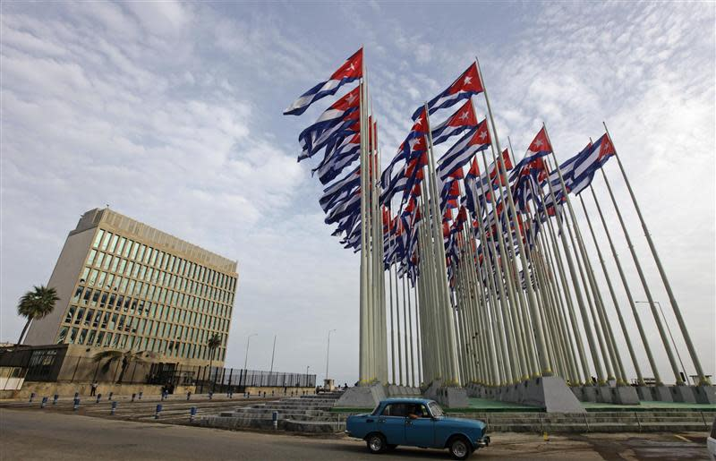File picture shows a car driving past the building of the the U.S. diplomatic mission in Cuba, The U.S. Interests Section, (USINT), in Havana