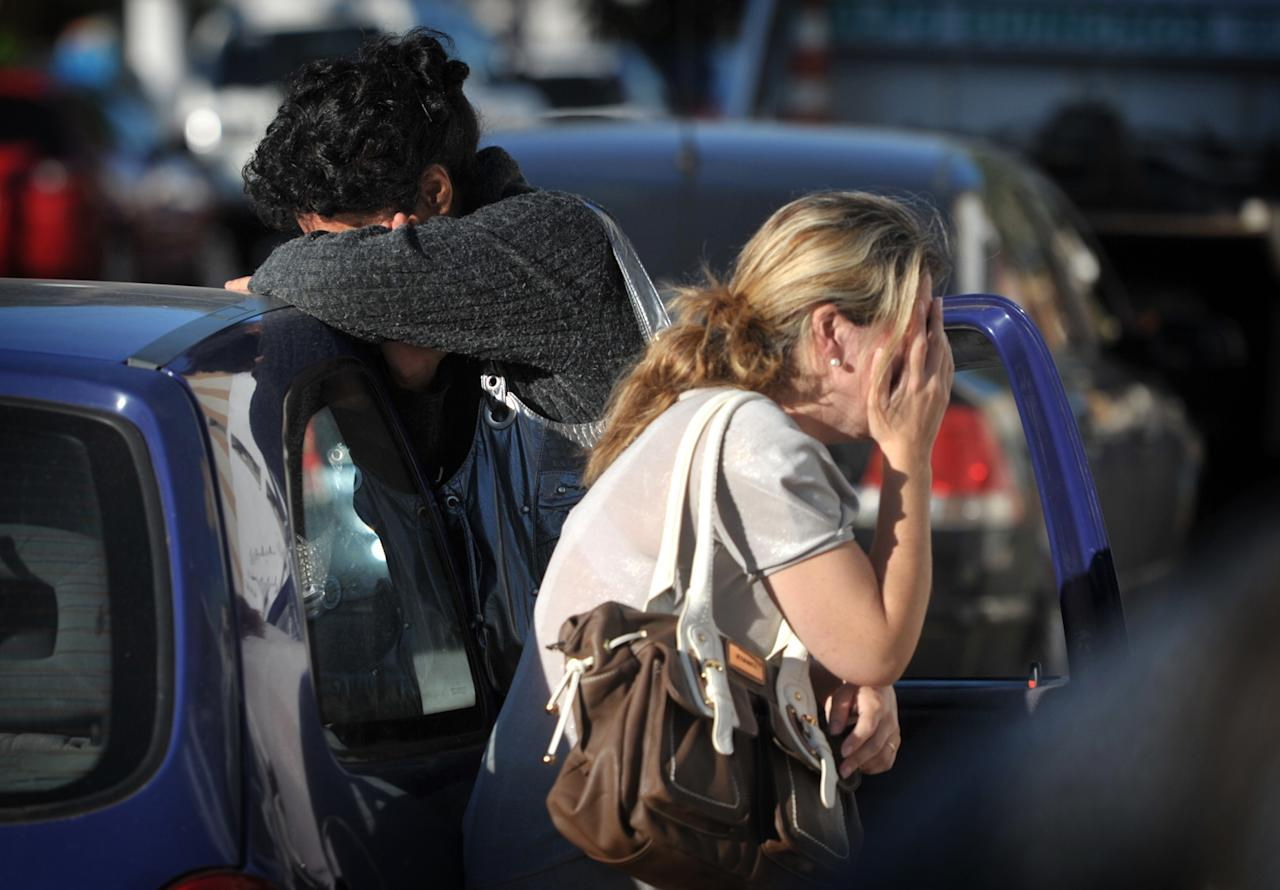 Relatives of victims react as they wait for news near the Kiss nightclub in Santa Maria city, Rio Grande do Sul state, Brazil, Sunday, Jan. 27, 2013. According to police more than 200 died in the devastating nightclub fire in southern Brazil. Officials say the fire broke out at the club while a band was performing. (AP Photo/Ronald Mendes-Agencia RBS)