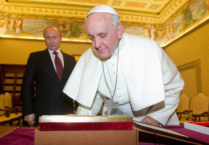 Pope Francis exchanges gifts with Russia's President Vladimir Putin during a private audience at the Vatican