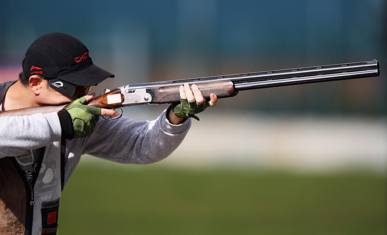 LONDON, ENGLAND - APRIL 27:  Yu Du of China in action during qualifying for the Men's Trap on day nine of the ISSF Shooting World Cup LOCOG Test Event for London 2012 at The Royal Artillery Barracks on April 27, 2012 in London, England.  (Photo by Bryn Lennon/Getty Images)