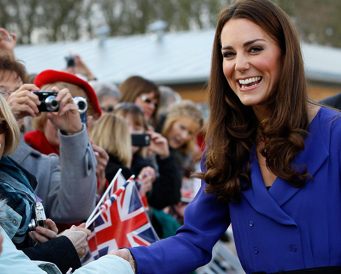 Kate Middleton embarked on her new royal duties in 2012, with appearances at Queen Elizabeth's Diamond Jubilee and the London Games, although a paparazzi cheap shot really got people's attention. (Kirsty Wigglesworth/AP Photo)