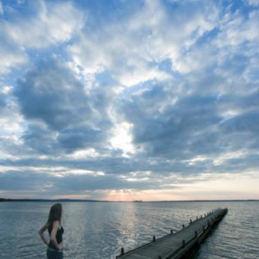Woman-on-dock-watching-cloudscape_web