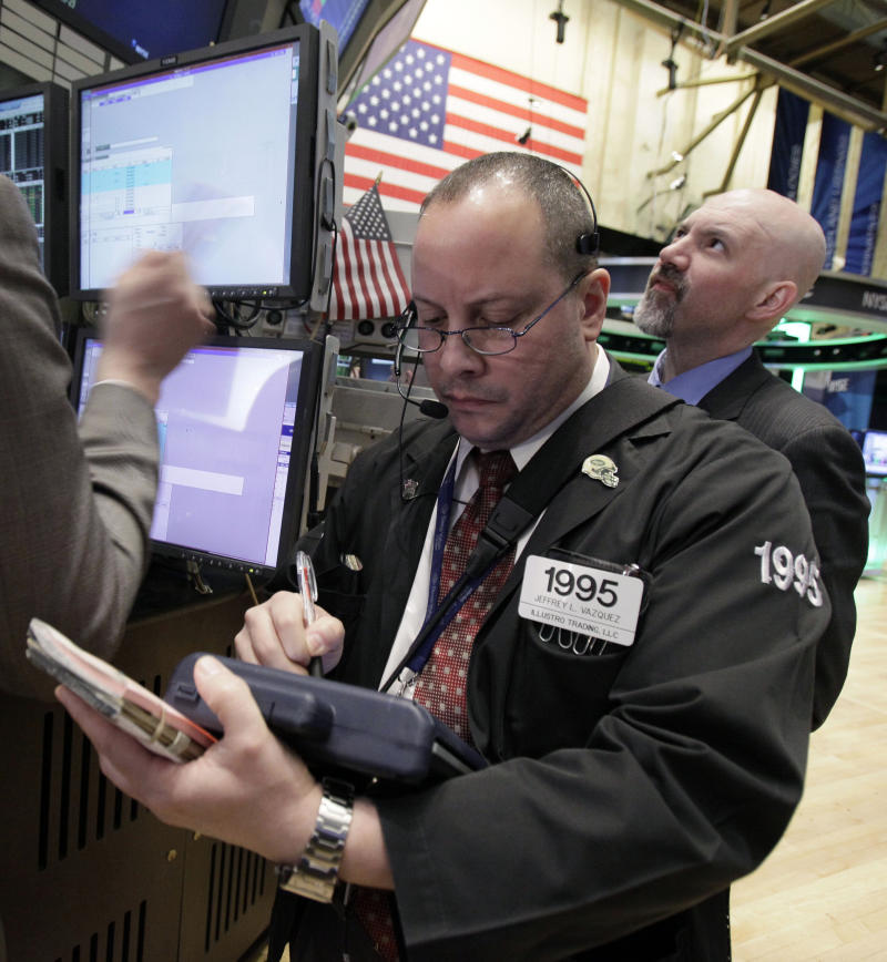 In this Feb. 2, 2012 photo, trader Jeffrey Vazquez, left, works on the floor of the New York Stock Exchange Thursday, Feb. 2, 2012.  World stock markets rose Wednesday, Feb. 15, 2012, after Greece indicated a willingness to commit to spending cuts to secure its bailout and moves by Japan's central bank to support the economy lifted its powerhouse export sector. (AP Photo/Richard Drew)