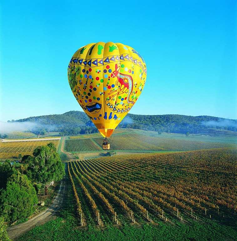 For that age-old romantic flair, nothing beats floating on a hot-air balloon over vineyards like Yarra Valley