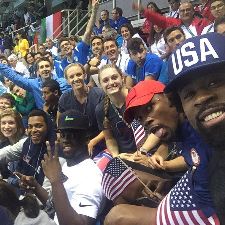 U.S. men's basketball team attends swimming event to cheer on Michael Phelps