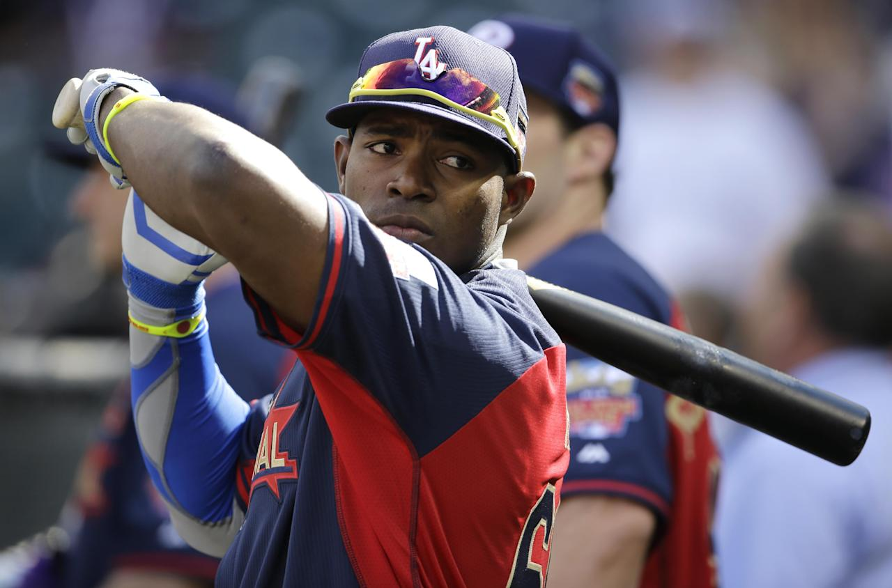 National League outfielder Yasiel Puig, of the Los Angeles Dodgers, waits to hit during batting practice before the MLB All-Star baseball game, Tuesday, July 15, 2014, in Minneapolis. (AP Photo/Paul Sancya)
