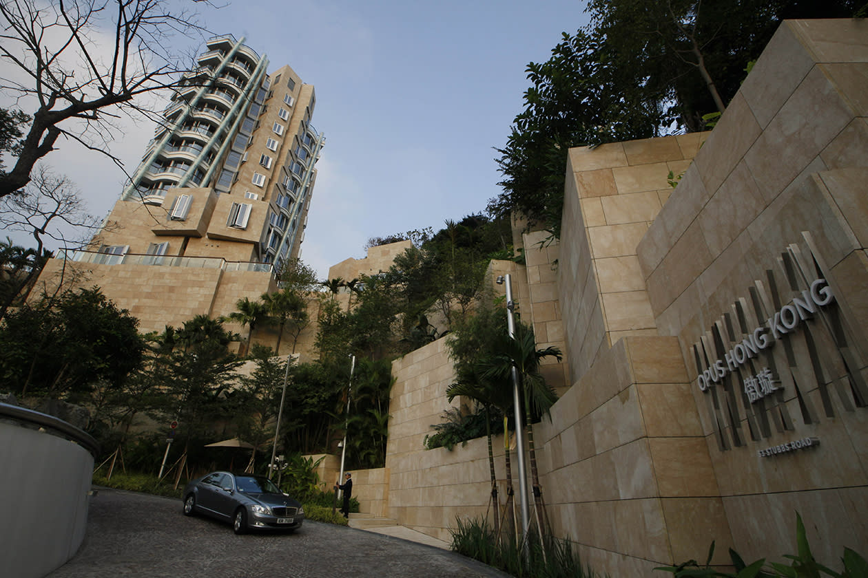 "A car leaves the luxury residential building ""Opus Hong Kong,"" designed by Frank Gehry in Mid-Levels East of Hong Kong."
