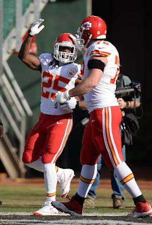 Jamaal Charles and Eric Fisher (Getty Images)