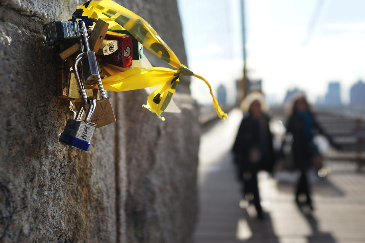 "NEW YORK, NY - FEBRUARY 13: ""Love locks"" are viewed on the Brooklyn Bridge, one of thousands that have been placed along the bridge recently on February 13, 2013 in New York City. The phenomenon has gained followers in recent years as couples seek to publicly mark weddings, engagements, and anniversaries in a permanent way. Besides New York, ""love locks"" can be found on public monuments and bridges in Venice, St. Petersburg and Paris amongst other cities.  (Photo by Spencer Platt/Getty Images)"