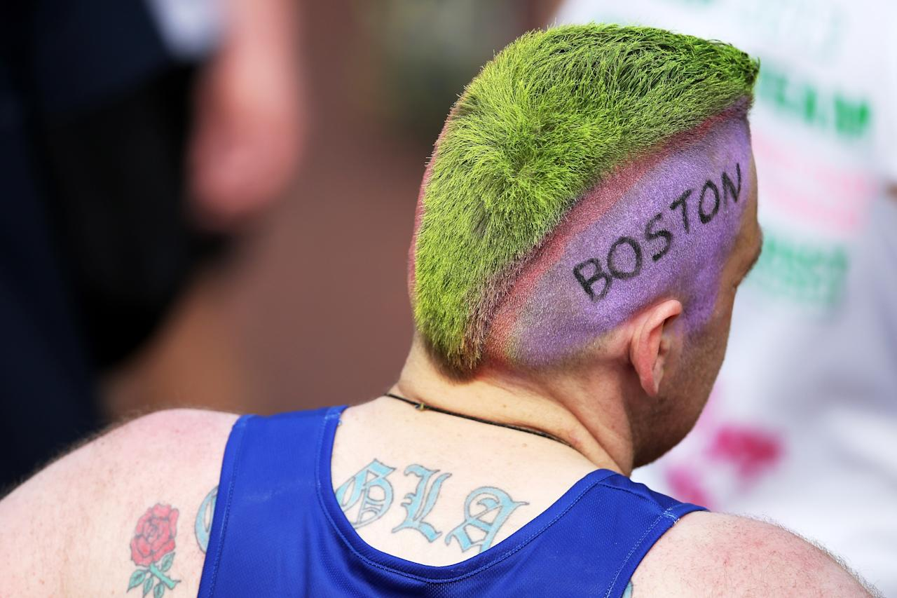 LONDON, ENGLAND - APRIL 21:  A competitor shows his sympathy towards the victims of the Boston Marathon bombing during the Virgin London Marathon 2013 on April 21, 2013 in London, England.  (Photo by Chris Jackson/Getty Images)