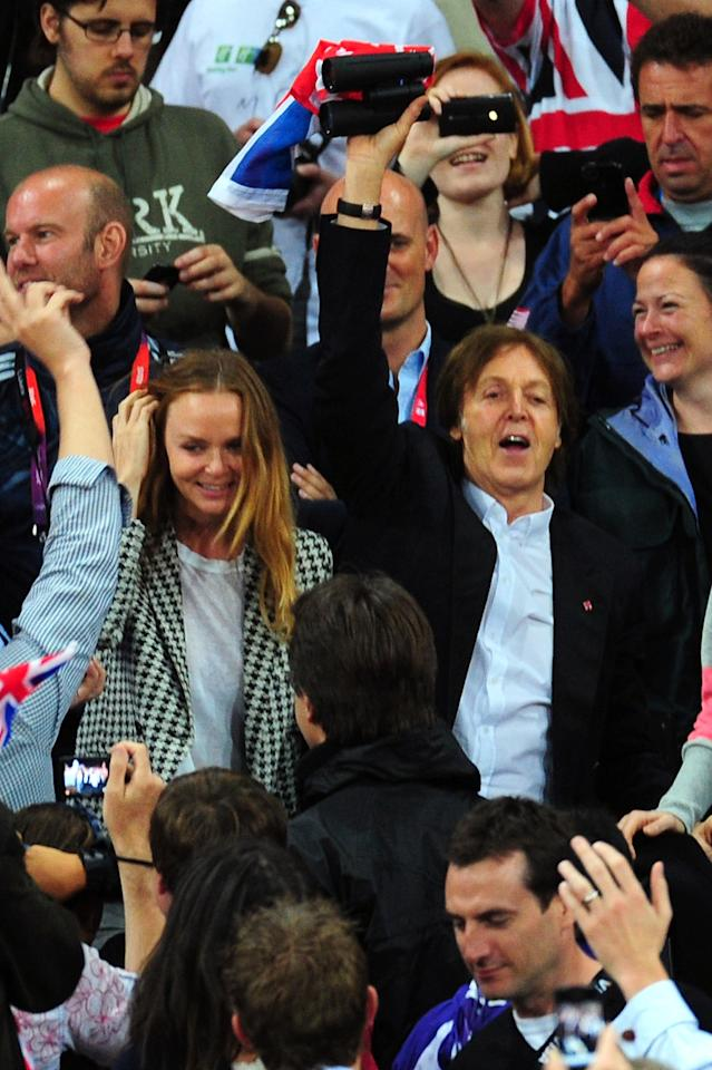 LONDON, ENGLAND - AUGUST 04:  (L-R) Designer Stella McCartney and Paul McCartney  cheer on the athletes on Day 8 of the London 2012 Olympic Games at Olympic Stadium on August 4, 2012 in London, England.  (Photo by Stu Forster/Getty Images)