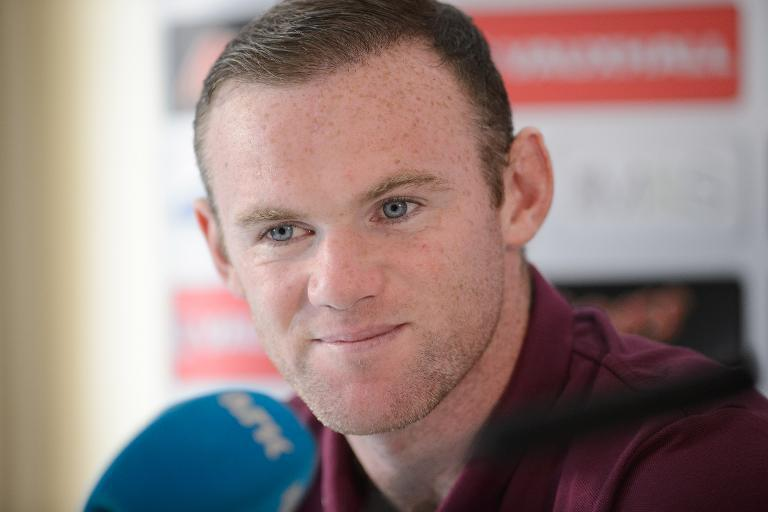 England captain Wayne Rooney takes questions from members of the media during a press conference in Watford on September 2, 2014