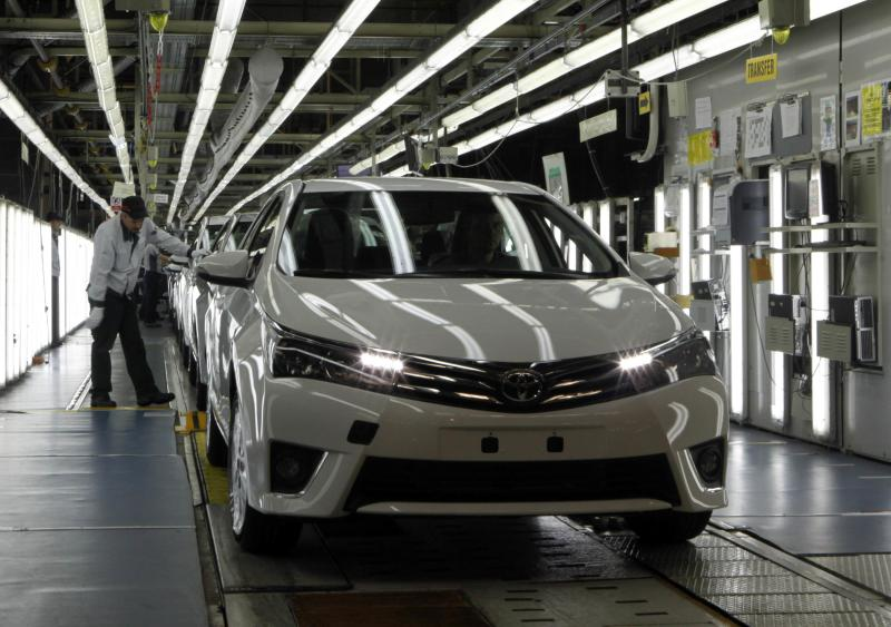 An employee works at an assembly line in the Toyota manufacturing plant in Sakarya