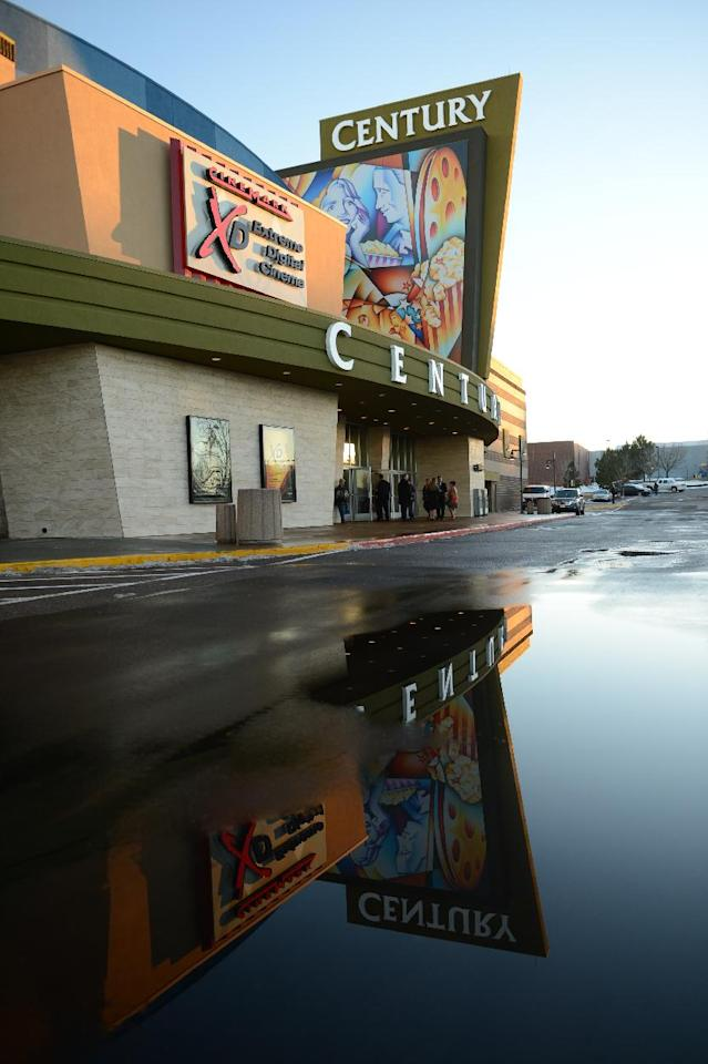 The remodeled Century Aurora cinema, formerly the Century 16, is reflected in large puddle in the parking before a reopening and remembrance ceremony Thursday, Jan. 17, 2013 in Aurora, Colo. The theater is where 12 people were killed and dozens injured in a shooting rampage last July. (AP Photo/The Denver Post, RJ Sangosti, Pool)